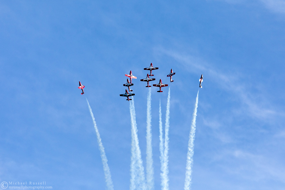 Canadian Forces Snowbirds beginning a Canada Burst from the Diamond formation with smoke.  The Snowbirds are also known as the 431 Air Demonstration Squadron and fly the Canadair CT-114 Tutor jet. Photographed during the Canada 150 celebrations in White Rock, British Columbia, Canada.