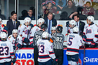 REGINA, SK - MAY 20: Regina Pats' head coach John Paddock speaks to linesman Chad Huseby and referee Jeff Ingram during a time out against the Acadie-Bathurst Titan at the Brandt Centre on May 20, 2018 in Regina, Canada. (Photo by Marissa Baecker/CHL Images)