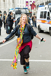 J11 protest.<br /> A protestor dancing on Regent Street during the J11 protest in central London by the StopG8 anti-capitalist movement,<br /> London, United Kingdom<br /> Tuesday, 11th June 2013<br /> Picture by Mark  Chappell / i-Images