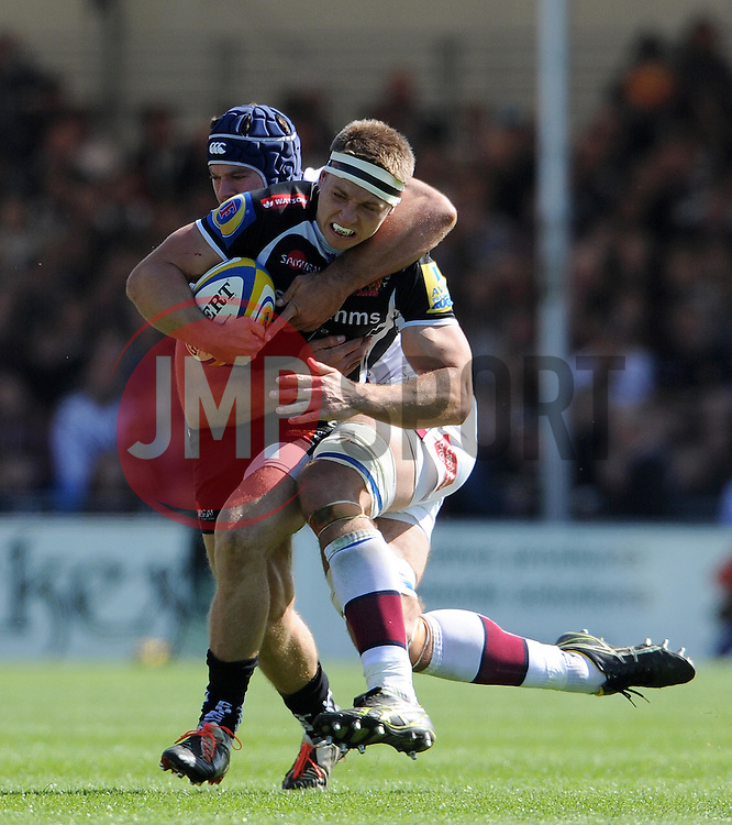 Exeter Chiefs Sam Hill is tackled by Sale Sharks Josh Beaumont Photo mandatory by-line: Harry Trump/JMP - Mobile: 07966 386802 - 16/05/15 - SPORT - RUGBY - Aviva Premiership - Exeter Chiefs v Sale Sharks - Sandy Park, Exeter, England.