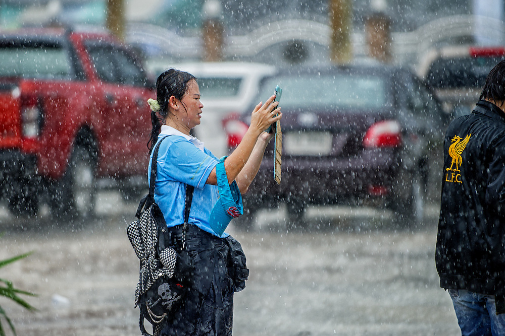 A determined iPad videographer records the Governor of Nakhon Nayok province in the rain as Thais celebrate HM Queen Sirikit's birthday in rural Thailand.