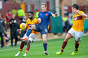 Steven MacLean (#18) of Heart of Midlothian tackles Andy Rose (#15) of Motherwell FC during the Ladbrokes Scottish Premiership match between Motherwell and Heart of Midlothian at Fir Park, Motherwell, Scotland on 15 September 2018.
