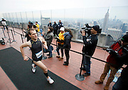 A runner completes the 6th annual MS Climb to the Top at the Rockefeller Center in New York, March 2, 2014. Over 1300 runners climbed 66 floors to support multiple sclerosis research. (INSIDER IMAGES/Stuart Ramson for Rockefeller Center)