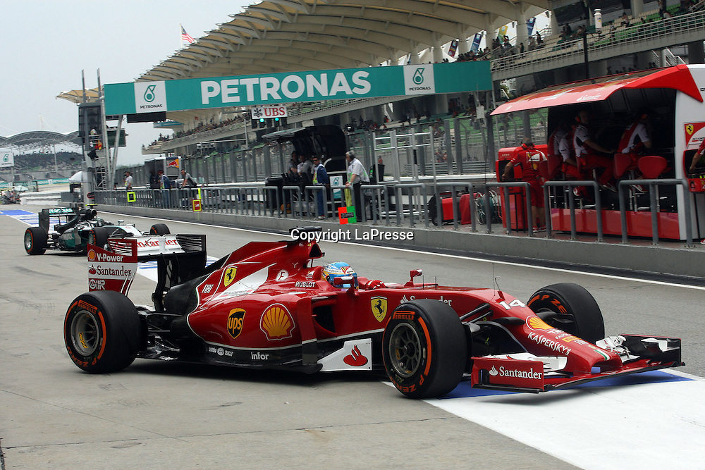 &copy; Photo4 / LaPresse<br /> 29/3/2014 Sepang, Malaysia<br /> Sport <br /> Grand Prix Formula One Malaysia 2014<br /> In the pic: Fernando Alonso (ESP) Scuderia Ferrari F14-T