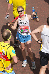 © Licensed to London News Pictures. 21/04/2013. London, England. Picture: Kelly Sotherton. Celebrity Runners and Fun Runners finish the Virgin London Marathon 2013 race in the Mall, London. Many wore black ribbons to pay their respect for those who died or were injured in the Boston Marathon. Photo credit: Bettina Strenske/LNP