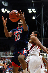 February 3, 2011; Stanford, CA, USA;  Arizona Wildcats guard Jordin Mayes (20) shoots past Stanford Cardinal forward Josh Huestis (24) during the first half at Maples Pavilion.