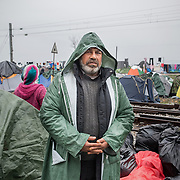 Samir, 48 yo, from Arfin, Aleppo county. He has been travelling for 25 days and he has been stuck at Idomeni camp for the past 12 days. Transit camp of Idomeni, Greece. <br /> <br /> Thousands of refugees are stranded in Idomeni unable to cross the border. The facilities are stretched to the limit and the conditions are appalling.