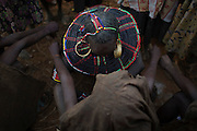 A Pokot woman performs a circumcision on a girl.