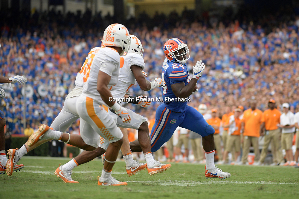 Florida running back Mark Thompson (24) rushes for yardage during the second half of an NCAA college football game against Tennessee Saturday, Sept. 16, 2017, in Gainesville, Fla. Florida won 26-20. (Photo by Phelan M. Ebenhack)