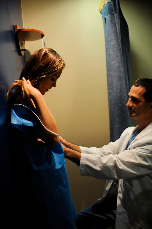 "Dr. Peter Römer, the plastic surgeon who operates on Miss Venezuela contestants sees a post-op patient in his office in Caracas, Venezuela. Dr. Römer says that he works with Osmel Sousa of the Miss Venezuela organization to ""polish"" their contestants to perfection. The most common procedures he performs on contestants is breast augmentation, nose jobs and liposuction."