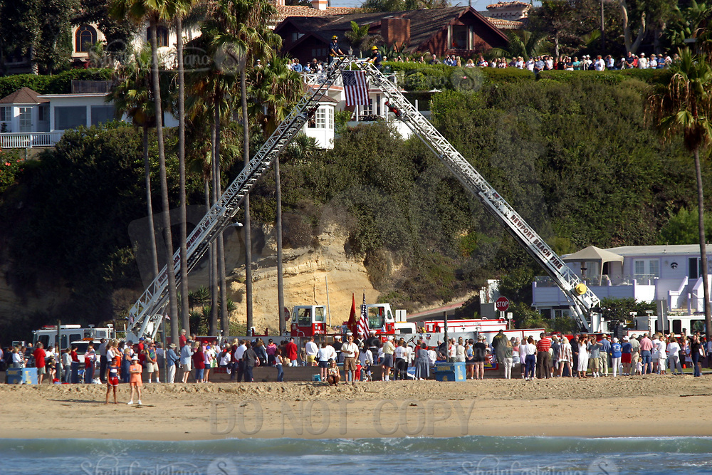 Sep 11, 2002; Corona Del Mar, California, USA; Newport Beach Fire Department performed 'Amazing Grace' alongside the Camp Pendleton Marine Corps Color Guard on shore at Big Corona beach. People gathered amongst the sea spray to watch four Tall Ships and private sail boats that paused to honor those who lost their lives on 9/11.<br />