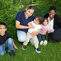Supportive Housing program case worker, Melissa (in white shirt) with her client Irma and three of Irma's four children: Joels, age 5, Delicia, age 3 and Julio, age 18 months. Melissa has provided support to Irma for over two years. <br />
