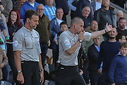 The referee wards Coventry City defender Aaron Martin his goal during the Sky Bet League 1 match between Burton Albion and Coventry City at the Pirelli Stadium, Burton upon Trent, England on 6 September 2015. Photo by Simon Davies.