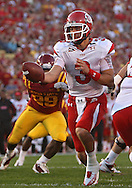 October 9 2010: Utah Utes quarterback Jordan Wynn (3) hands the ball off during the first half of the NCAA football game between the Utah Utes and the Iowa State Cyclones at Jack Trice Stadium in Ames, Iowa on Saturday October 9, 2010. Utah defeated Iowa State 68-27.