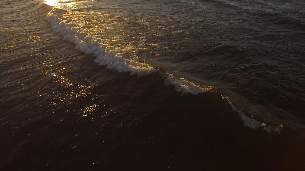 4K STILL FROM VIDEO: Great Lakes surfing on Lake Superior at Marquette, Michigan.