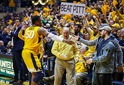 Dec 8, 2018; Morgantown, WV, USA; West Virginia Mountaineers forward Sagaba Konate (50) celebrates with fans after beating the Pittsburgh Panthers at WVU Coliseum. Mandatory Credit: Ben Queen-USA TODAY Sports