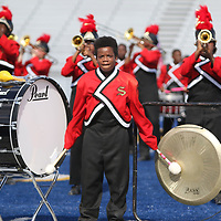 Kimial Bowen strikes the drum and gong during Shannon's funky marching band performance Saturday at Tupelo High School