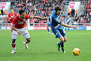 Bristol City midfielder Korey Smith holds up Birmingham City midfielder Will Buckley during the Sky Bet Championship match between Bristol City and Birmingham City at Ashton Gate, Bristol, England on 30 January 2016. Photo by Alan Franklin.