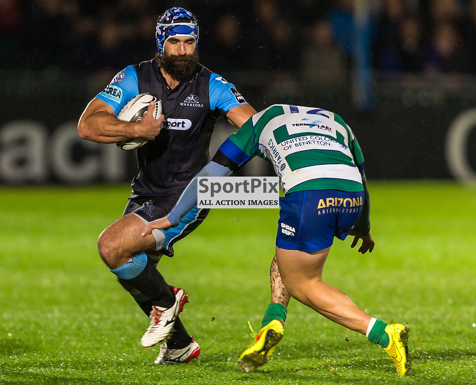 Josh Strauss hands off Enrico Bacchin during the Guinness Pro 12 clash between Glasgow Warriors and Treviso  (c) ROSS EAGLESHAM | SportPix.co.uk