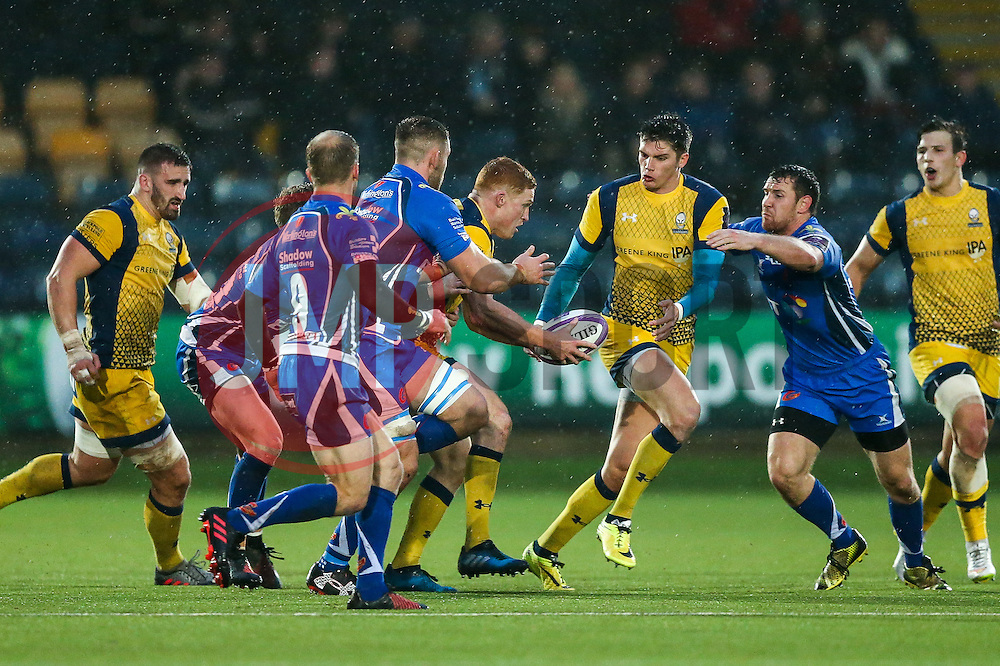 Connor Braid of Worcester Warriors offloads to Ben Howard - Rogan Thomson/JMP - 10/12/2016 - RUGBY UNION - Sixways Stadium - Worcester, England - Worcester Warriors v Newport Gwent Dragons - European Rugby Challenge Cup.