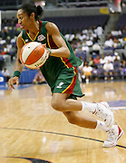 Seattle Storm forward Iziane Castro Marques drives to the basket during this WNBA game between the Mystics and the Storm at the Verizon Center in Washington, DC. The Storm won 73-71.  July 23, 2006  (Photo by Mark W. Sutton)