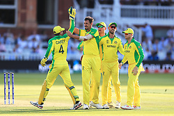 Australia's Mitchell Starc (centre) celebrates the wicket of New Zealand's Kane Williamson during the ICC Cricket World Cup group stage match at Lord's, London.