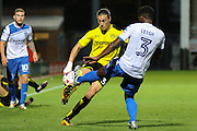Bury FC defender Greg Leigh (3) blocks the ball from Burton Albion midfielder Jackson Irvine (36) during the EFL Cup match between Burton Albion and Bury at the Pirelli Stadium, Burton upon Trent, England on 10 August 2016. Photo by Aaron  Lupton.