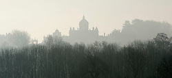 © Licensed to London News Pictures. 06/02/2017. Castle Howard, North Yorkshire, UK.  Castle Howard, North Yorkshire is seen through the mist on a cold morning.  Photo credit: Anna Gowthorpe/LNP