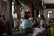 Patients wait to see a doctor at Oakahta Yama Monastery in South Dagon township on June 29, 2014.