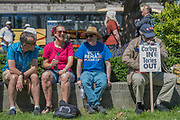 The protest was good natured but the police were always in teh background - A day after the election result protestors gather to ask for Theresa May to quit and not do a deal with the DUP. Who people fear because of their views on abrtion, gay marriage etc. Westminster, London, 10 Jun 2017