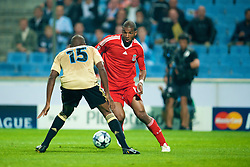 MARSEILLE, FRANCE - Tuesday, September 16, 2008: Liverpool's Ryan Babel and Olympique de Marseille's Ronald Zubar during the opening UEFA Champions League Group D match at the Stade Velodrome. (Photo by David Rawcliffe/Propaganda)