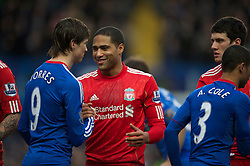 LONDON, ENGLAND - Sunday, February 6, 2011: Liverpool's Glen Johnson and Chelsea's Fernando Torres during the Premiership match at Stamford Bridge. (Photo by David Rawcliffe/Propaganda)