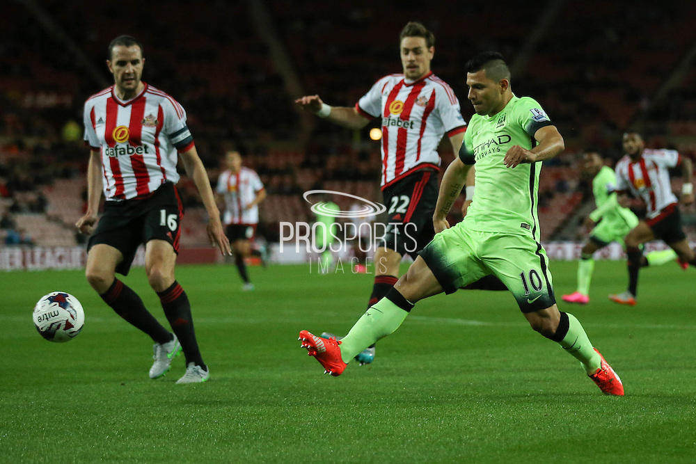 Manchester City forward Sergio Aguero stabs the ball goalwards during the Capital One Cup match between Sunderland and Manchester City at the Stadium Of Light, Sunderland, England on 22 September 2015. Photo by Simon Davies.