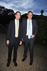 Left to right, WILLIAM AITKEN and his father JONATHAN AITKEN at a Summer party hosted by Lady Annabel Goldsmith at her home Ormeley Lodge, Ham, Surrey on 14th July 2009.