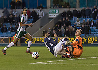 Football - 2017 / 2018 FA Cup - Third Round: Millwall vs. Barnsley<br /> <br /> Adam Davies (Barnsley FC) and Conor McLaughlin (Millwall FC) collide after the Millwall player sees his shot saved at The Den.<br /> <br /> COLORSPORT/DANIEL BEARHAM
