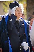 Evelyn G. Bass, 88, salutes the American flag as Taps is played during Memorial Day ceremonies at the Town Square. Bass served in the U.S. Coast Guard from 1944 to 1946.