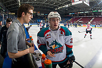 KELOWNA, CANADA - JANUARY 25: Equipment manager Chaydyn Johnson stands on the bench speaking to Kyle Topping #24 of the Kelowna Rockets during warm up against the Victoria Royals on January 25, 2019 at Prospera Place in Kelowna, British Columbia, Canada.  (Photo by Marissa Baecker/Shoot the Breeze)