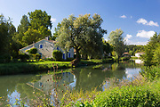 Traditional quaint picturesque house by River La Sevre-Niortaise at Coulon in Marais Poitrevin region a Grand Site de France