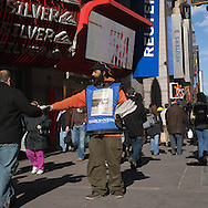 New York -Manhattan pedestrions on 42nd street  in the street of Times square area.