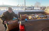 Chris Burke of Marion loads food boxes in the back of a pickup as the Society of St. Vincent de Paul delivers 237 holiday meals to families in Cedar Rapids, Marion, and Hiawatha from the St. Wenceslaus Church gym at 1230 5th St SE in Cedar Rapids on Saturday morning, December 22, 2012. (Stephen Mally/Freelance)