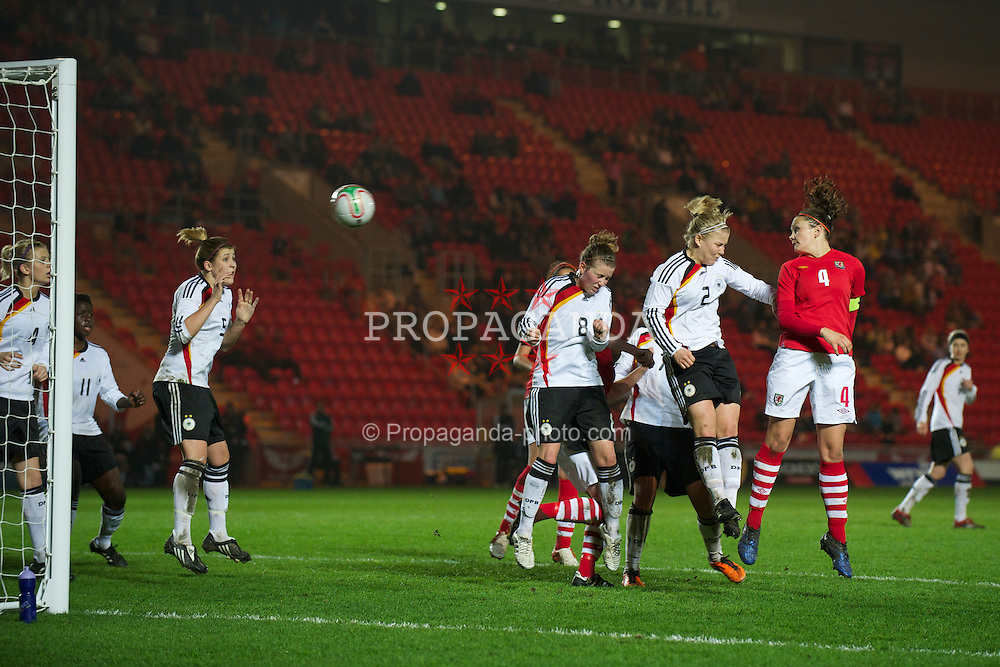 LLANELLI, WALES - Thursday, March 31, 2011: Wales' captain Nia Jones rises above Germany's Leonie Maier to score the equalising goal to claim a 1-1 darw during the UEFA European Women's Under-19 Championship Second Qualifying Round (Group 3) match at Parc Y Scarlets. (Photo by David Rawcliffe/Propaganda)