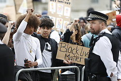 © Licensed to London News Pictures. 03/06/2020. London, UK. Members of the campaign group Black Lives Matter and supporters, gather outside Downing Street, central London to demonstrate, following the death of African American George Floyd while in police custody. The death of George Floyd, who died after being restrained by a police officer In Minneapolis, Minnesota, has caused widespread rioting and looting across the USA. Photo credit: Peter Macdiarmid/LNP