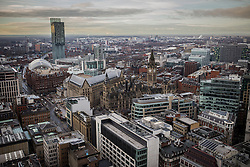 © Licensed to London News Pictures . 07/12/2013 . Beetham Tower , Manchester Town Hall , Gmex , Manchester Central , Midland Hotel . Cityscape view taken from the roof of City Tower , Piccadilly , Manchester . Photo credit : Joel Goodman/LNP