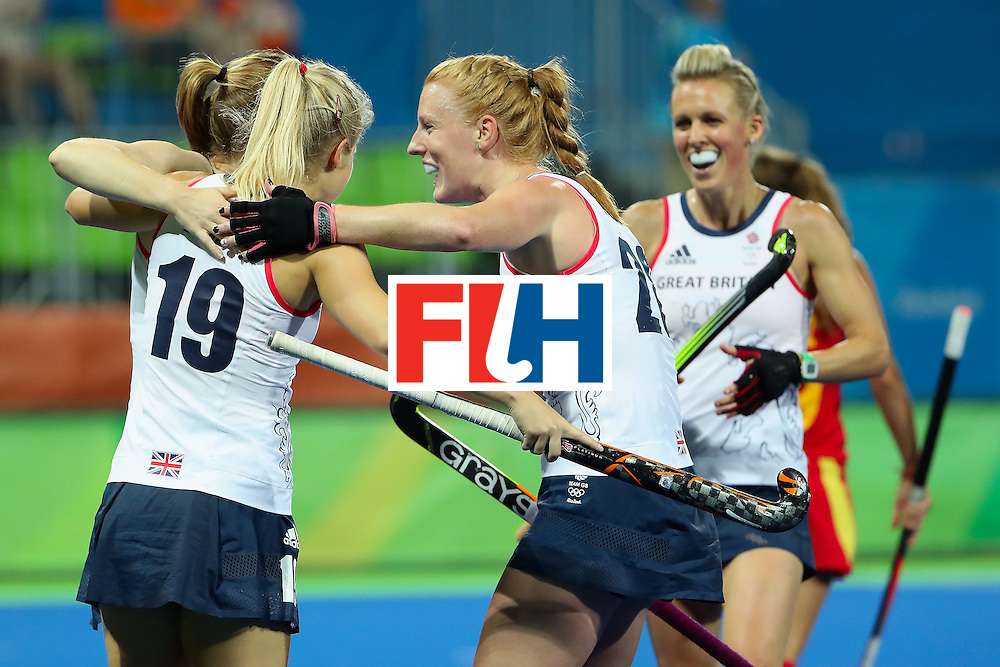 RIO DE JANEIRO, BRAZIL - AUGUST 15:  (L-R) Helen Richardson-Walsh #8, Sophie Bray #19 and Nicola White #28 of Great Britain celebrate after Richardson-Walsh scored a first half goal against Spain during the quarter final hockey game on Day 10 of the Rio 2016 Olympic Games at the Olympic Hockey Centre on August 15, 2016 in Rio de Janeiro, Brazil.  (Photo by Christian Petersen/Getty Images)