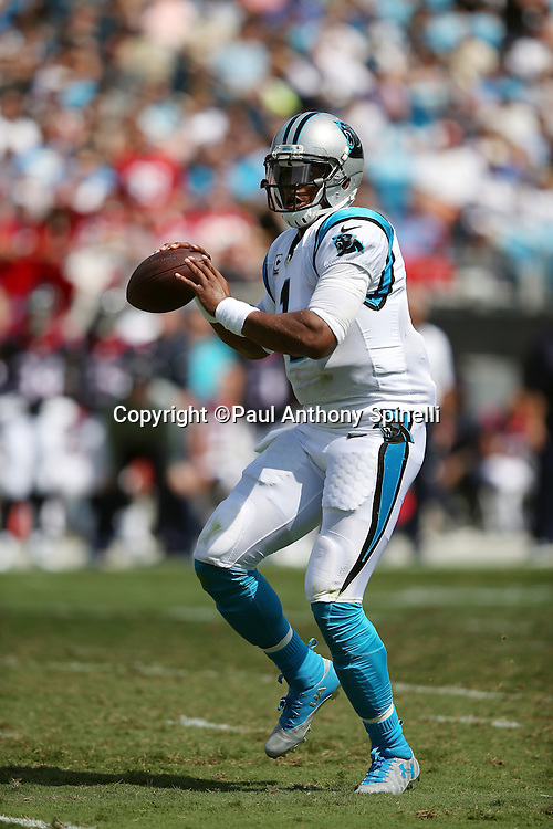 Carolina Panthers quarterback Cam Newton (1) scrambles and looks to throw a pass during the 2015 NFL week 2 regular season football game against the Houston Texans on Sunday, Sept. 20, 2015 in Charlotte, N.C. The Panthers won the game 24-17. (©Paul Anthony Spinelli)