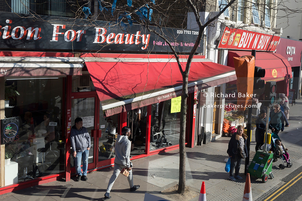 An awning for the beauty bar Passion For Beauty is broken and twisted on the Walworth Road in Southwark, on 26th February 2019, in London, England.