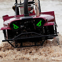 NAPLES, FL -- March 6, 2011 -- Wayne Miller drives the Phantom through the water during the Swamp Buggy Races at the Florida Sports Park in Naples, Fla., on Sunday, March 6, 2011.  The races originated in the 1940's by bored hunters and draws thousands of fans three times a year to take in the buggies and jeep compete in the swamp. (Chip Litherland for ESPN the Magazine)