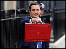 The Chancellor George Osborne poses on the steps of No11 Downing street with his red budget box for the 2014 Budget, London, United Kingdom. Wednesday, 19th March 2014. Picture by Andrew Parsons / i-Images