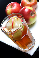 Glass of apple juice with ice
