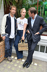Left to right, VISCOUNT MACMILLAN, CHARLOTTE DELLAL and ARPAD BUSSON at the launch of the new collection from Limoland held at Anderson & Sheppard's Haberdashery, 17 Clifford Street,London on 16th June 2014.